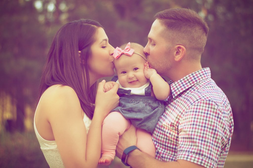 Beautiful couple with a baby
