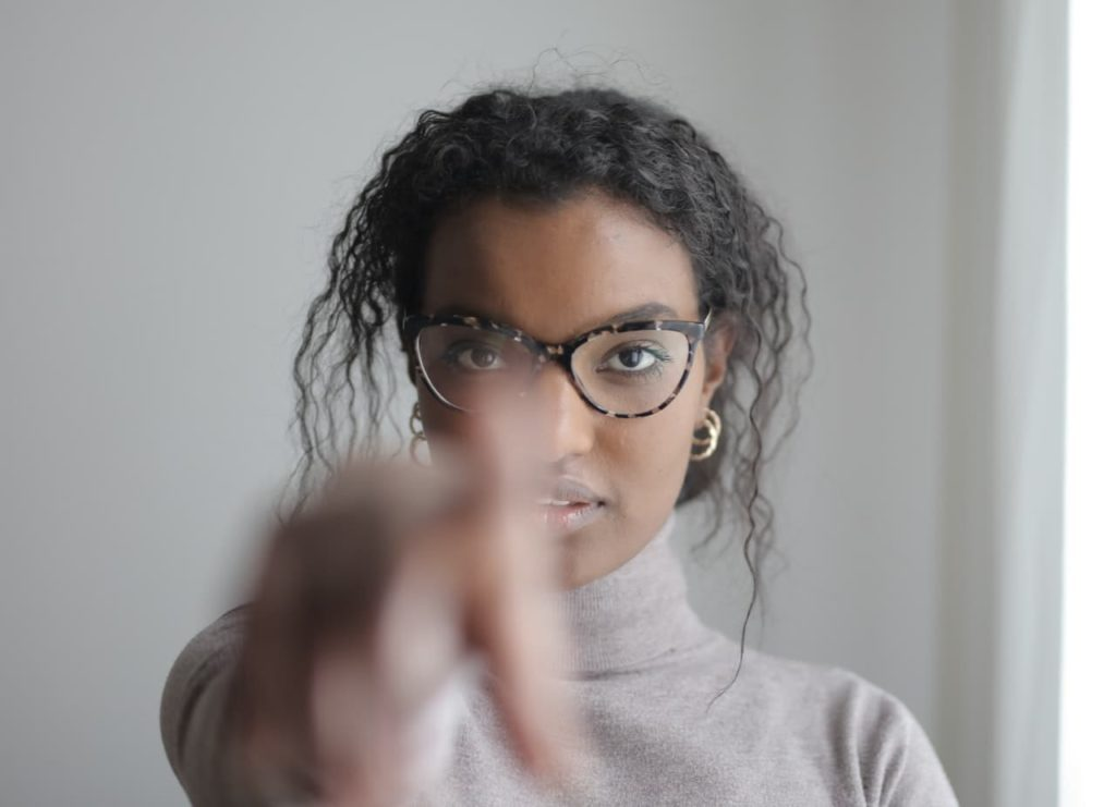 Young black girl pointing
