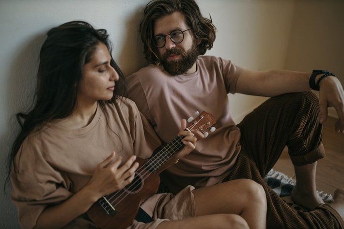 Couple playing guiter
