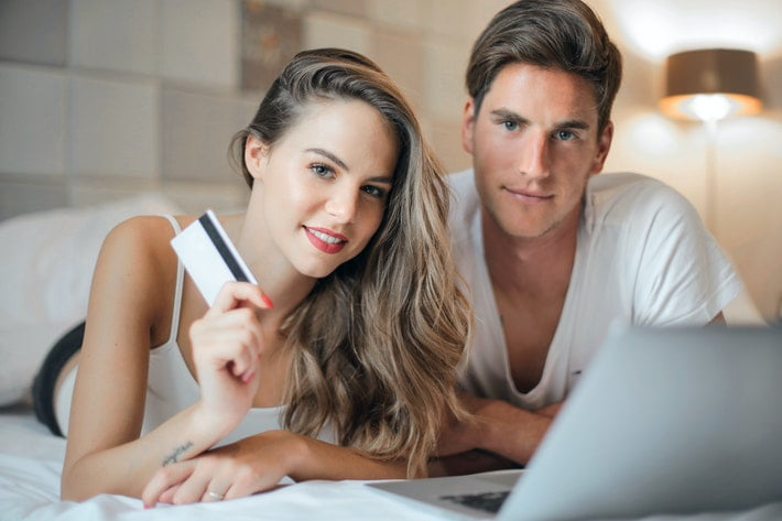 Couple using a credit card to buy online