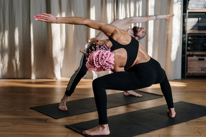 Couple doing yoga on Valentine's Day